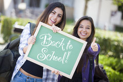 Back to School 2 Mixedrace Students and Chalkboard Stock Photos