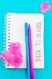 Back to school note on a notebook page. Back to school note written on a notebook page Stock Image