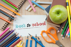 `Back to School` on note paper about with education Stock Photos