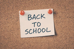 Back to school. Note pin on the bulletin board Stock Photos
