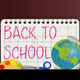 Back to school. Notebook on red background Royalty Free Stock Image