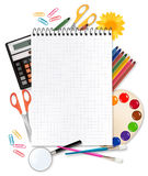 Back to school. Notepad with school supplies. Stock Photos