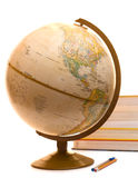 Back To School Objects. Including a globe, some books and a pen and pencil Royalty Free Stock Images