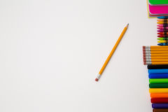 Back to school office items from above. Back to school office supplies white background paper pencil pen color crayon marker royalty free stock photo