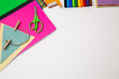 Back to school office items from above. Back to school office supplies white background paper pencil pen color crayon marker royalty free stock photography