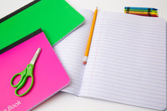 Back to school office items from above. Back to school office supplies white background paper pencil pen color crayon marker royalty free stock image