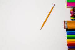 Back to school office items from above. Back to school office supplies white background paper pencil pen color crayon marker royalty free stock photos