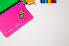 Back to school office items from above. Back to school office supplies white background paper pencil pen color crayon marker stock image