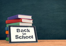 Back to school. One tablet pc with text: back to school, a stack of book and chalkboard on background with empty space 3d render Royalty Free Stock Photo