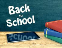 Back to school. One tablet pc on a wooden text, a stack of book at the right and a chalkboard on background with text: back to school (3d render Royalty Free Stock Photo