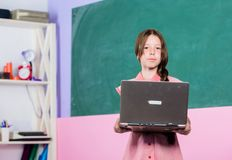 Back to school. Online education. childhood study online. knowledge day 1st september. small girl pupil with laptop. 4G. Internet. smart school girl in stock photo