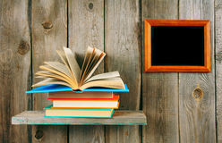 Back to school. The open book on a wooden shelf. Royalty Free Stock Images