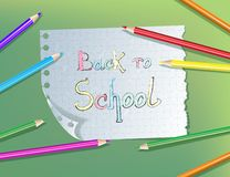 Back to school pencil text drawing in paper notebook with colore stock illustration