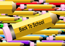 Back to school Pencils 2. Large yellow pencil with Back to school written on it.  Background of assorted pencils layered and moving from left to right. Creating Royalty Free Stock Photos
