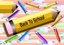 Back to school Pencils. Large yellow pencil with Back to school written on it. Surrounded  by scattered colored pencils. Background of assorted pencils layered Stock Photo