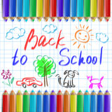 Back to school, pencils on the background of a notebook page Stock Images
