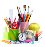 Back to School. Pencils and pens in cups. On the table Royalty Free Stock Image