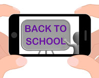 Back To School Phone Shows Learning And Stationery Supplies Royalty Free Stock Images
