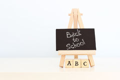 Back to school. Photo with text on chalkboard Royalty Free Stock Photos