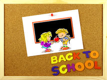 Back to School phrase on a corkboard Royalty Free Stock Image