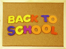 Back to School phrase on a corkboard Royalty Free Stock Images