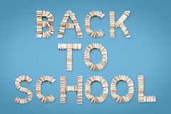 BACK TO SCHOOL phrase arranged from books. BACK TO SCHOOL phrase formed from books, shot from above on light blue background Stock Image