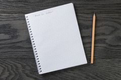 Back to school phrase in notepad with chequered Stock Images