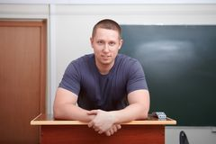Back to school. Portrait of student at tribune. Royalty Free Stock Photo