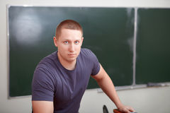 Back to school. Portrait of student at tribune. Royalty Free Stock Images