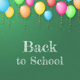 Back to school poster with text on chalkboard and color ballons Royalty Free Stock Images