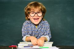Back to school. Preschooler. School lessons. Kids education. School and education concept. Science education concept. Funny little boy pointing up on royalty free stock photos