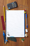 Back to School pupils note pad and stationary. On wooden school desk from above Royalty Free Stock Photo