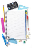 Back to School pupils note pad and stationary. On white school desk from above Stock Photos