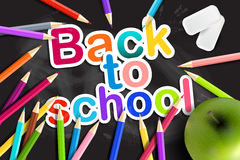 Back  to school. Rainbow  pencils, eraser and green apple on a b Stock Photography