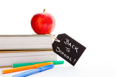 Back to School - Red Apple, books and pens Royalty Free Stock Images