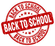 Back to school red grunge round rubber stamp Royalty Free Stock Image