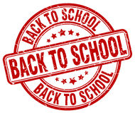 Back to school red grunge round vintage stamp Royalty Free Stock Photo