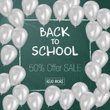 Back to School sale background on the chalkboard with sale percentages. Marketing poster with balloons. Royalty Free Stock Photo