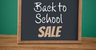 Back to school sale text on blackboard Stock Photos