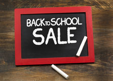Back to School Sale on Wooden Frame Chalkboard with Chalks royalty free stock photography