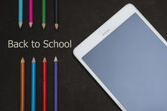 Back to school scenery. Stationery of student are on a black board Royalty Free Stock Image