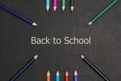 Back to school scenery. Stationery of student are on a black board Royalty Free Stock Photos