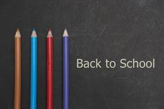 Back to school scenery. Stationery of student are on a black board Royalty Free Stock Images
