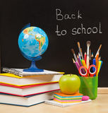 Back to school. School board and books Stock Photo