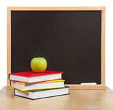Back to school. School board and books isolated Stock Photos
