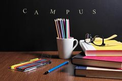 Back to school. School Stationery  are on the table infront of a black board Royalty Free Stock Photography