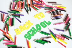 Back to school ,School supplies colored pencils in Fall scattered, isolated Stock Photo