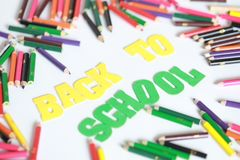 Back to school ,School supplies colored pencils in Fall scattered, isolated Royalty Free Stock Photos