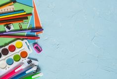 Back to school. School supplies - notebooks, pens, pencils, paint on a blue background, top view. Education concept. Flat lay Royalty Free Stock Image