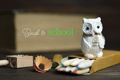 Back to school: School supplies and owl. Back to school: School supplies and an owl Royalty Free Stock Photography